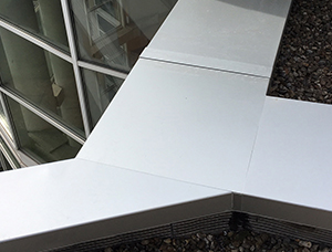 couvernet-couvertine-aluminium-protection-infiltration-etanche-toiture-coiffe-facades-couvertines-acrotere-murets